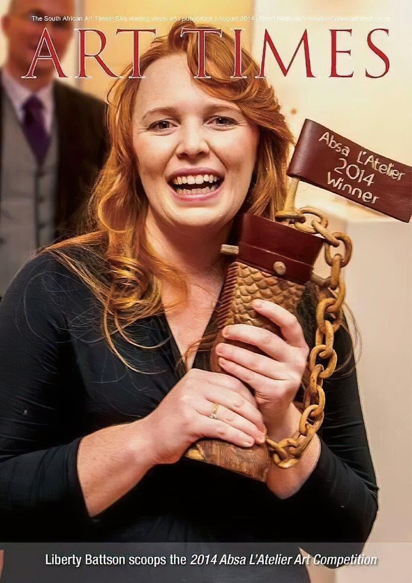 Photo of Liberty holding award trophy